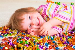 girl on pile of candy