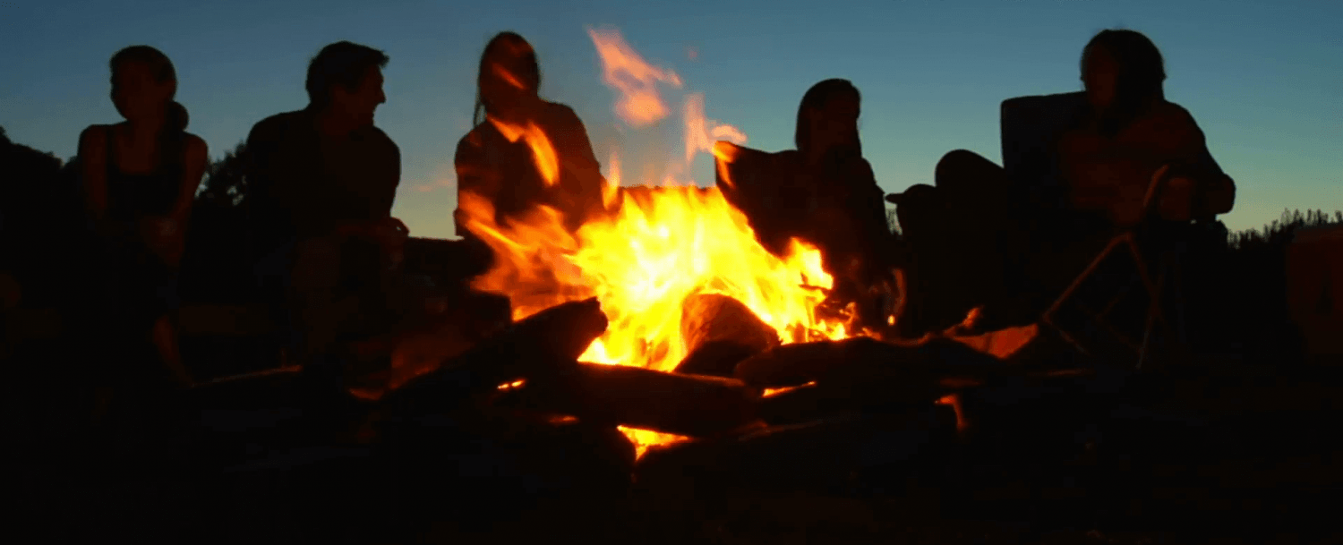 silhouettes-of-people-sitting-around-campfire